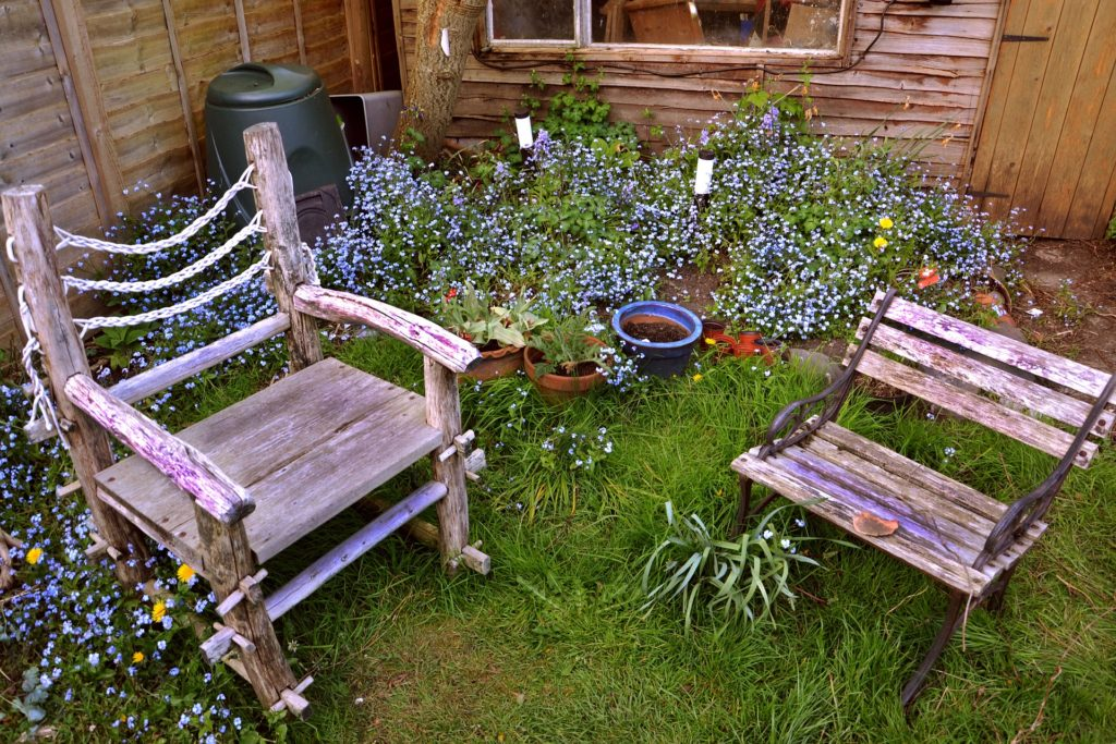 chairs as a focal point in small yard garden