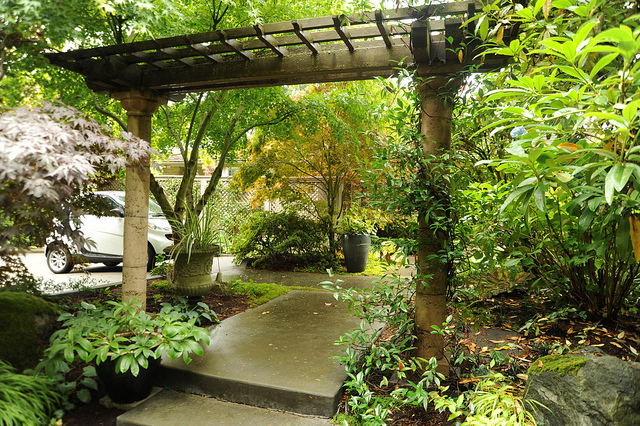 arbor path pathway two post wooden concrete outdoor design garden walkway  green plants - What's The Difference Between A Pergola And An Arbor?