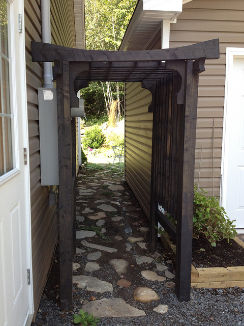 arbor wooden dark stained outdoor pathway entrance pergola style side path - What's The Difference Between A Pergola And An Arbor?