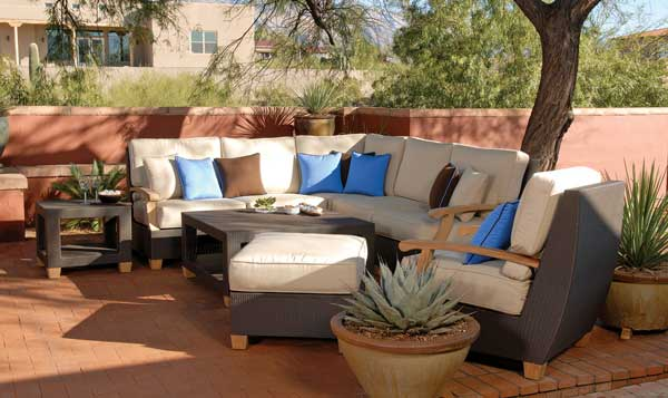 chic and modern teak and wicker outdoor sofas